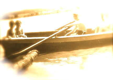 Canoe Balsam Lake 1940s Faded Sepia Image 1940's boy rowing two small children