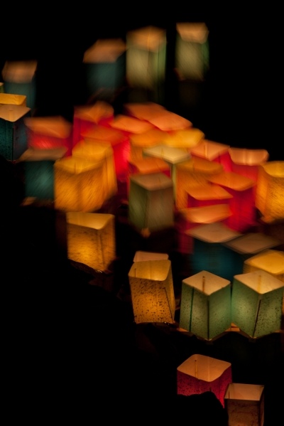 Multi Coloured Glowing Paper Lanterns Floating Water Night