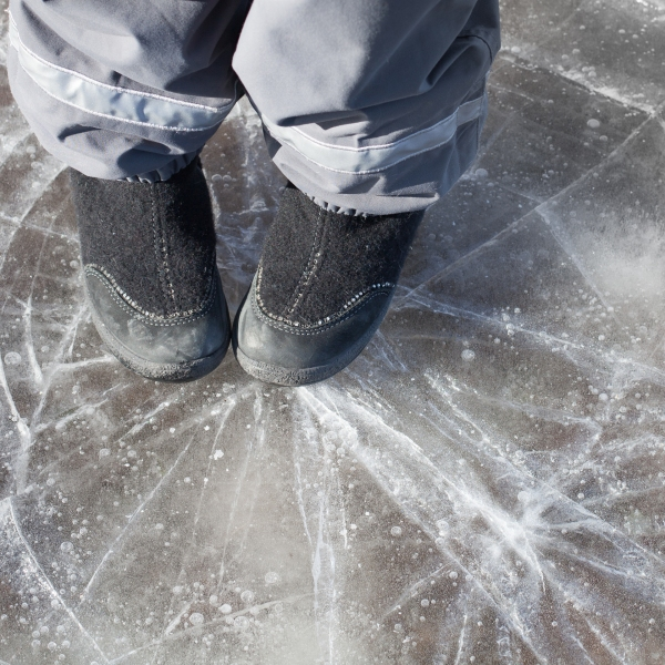 Image of someone standing on thin ice cracking