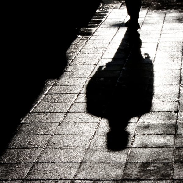 Blurry shadow and silhouette of a man